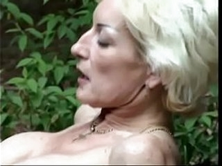 Milf blonde was fucked by a young cock at picnic in the woods